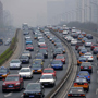 Cars crowd Beijing roads again