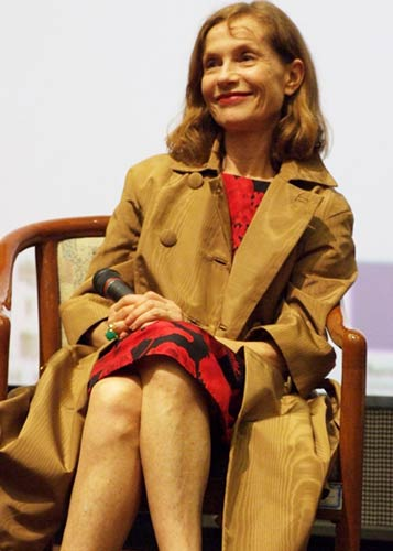 French actress Isabelle Huppert talks to Chinese movie fans at the China Film Archive on June 18, 2009.