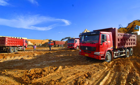 Workers work at the construction site of the Changjiang Nuclear Power Plant, south China's Hainan Province, July 1, 2009. With a total investment of 17 billion yuan, the construction of the first stage of the Changjiang project with two units that generate 650,000 kilowatts each is expected to be started this October and put into practice in 2014. The two units will use advanced second-generation pressurized water reactor technology. [Zhao Yingquan/Xinhua]