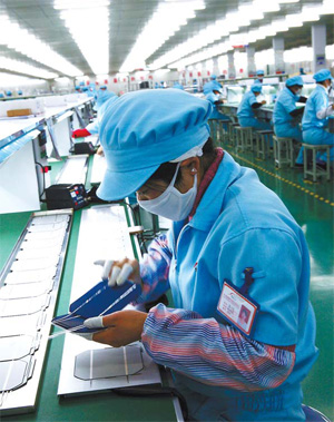 Workers at a solar PV cell factory in Jiangsu province. Solar PV cells are considered vital to address the nation's energy needs. [CFP]