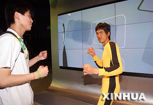 A visitor looks on a Bruce Lee wax figure in the Madam Tussauds Museum in Shanghai on this file photo.