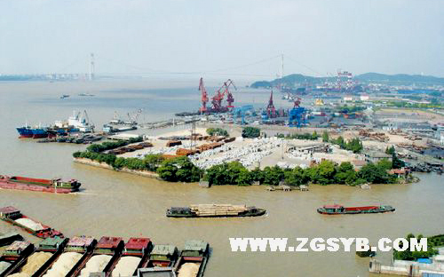 TThe file photo shows the bustling transportation port of Jiangyin Port Container Co. Ltd., in Wuxi City of Jiangsu Province. A complaint from more than 80 households says the company has caused air, noise and water pollution and damaged the quality of the air, drinking water and living environment of the surrounding residential areas.