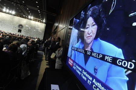 US Supreme Court nominee Judge Sonia Sotomayor is pictured on a monitor at the start of her US Senate Judiciary Committee confirmation hearings on Capitol Hill in Washington, July 13, 2009. [China Daily/Agencies]