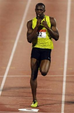 Olympic champion Usain Bolt defied heavy down pour to run the fourth fastest 200 meters time ever to win the Lausanne Grand Prix in 19.59 seconds on Tuesday.