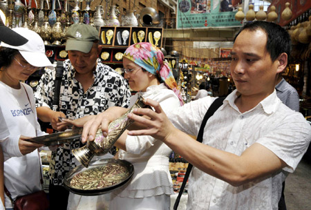 Urumqi's Int'l Bazaar reopens after deadly riot