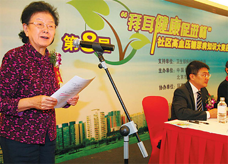 Professor, Yuan Shenyuan, from Beijing Tongren hospital, calls on residents to join a community healthcare contest. Bayer's healthcare division and the Ministry of Health became partners in an anti-diabetes campaign. File photo