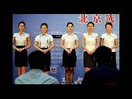 Candidates wait for the interview for air hostess of the China Southern Airlines on August 15 in Beijing. More than 6,000 candidates joined the selection activity in Beijing selection area for the position. Those who are chosen will serve on the flight during the 2010 Guangzhou Asian Games. Some 400 air hostesses will be selected from 7 selection regions throughout China. (China.org.cn/CFP)