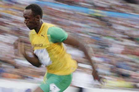 Jamaica's Usain Bolt competes during the men's 200m semifinal of the 2009 IAAF Athletics World Championships in Berlin, Germany, Aug. 19, 2009. Bolt clocked 20.08 seconds and was qualified for the final. (Xinhua/Liao Yujie