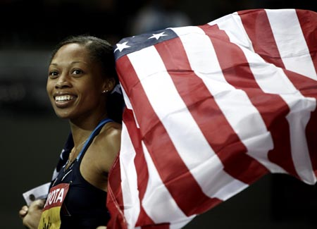 American Allyson Felix celebrates her victory in women's 200 meters final at the World Athletics Championships in Berlin, capital of Germany, August 21, 2009. Felix beat arch rival Veronica Campbell of Jamaica to win her third successive women's 200 meters title at the World Championships here on Friday by clocking 22.02 seconds. (Xinhua/Liao Yujie)
