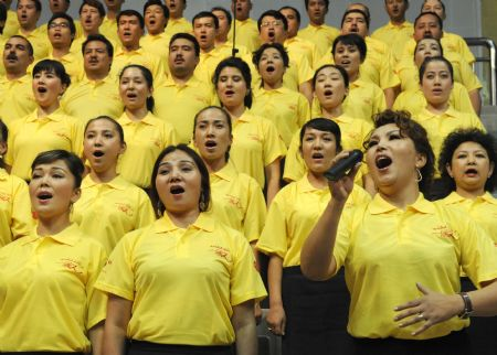 People perform a song named 'I love you, China' during a celebration to greet the coming 60th anniversary of the founding of the People Republic of China in Urumqi, capital of northwest China