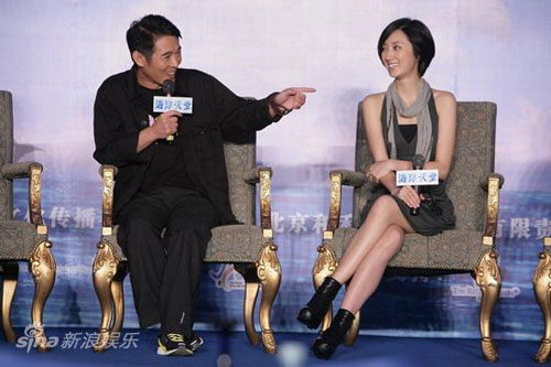 Jet Li (L) gestures to Kwai Lun-mei at a press conference for 'Ocean Paradise' on August 26, 2009 in Beijing.