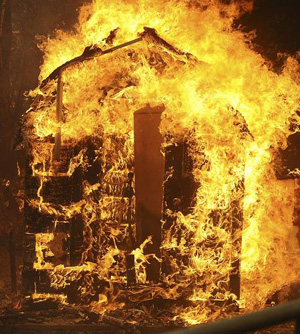 Flames burn down a house in the Big Tujunga Canyon area during the Station Fire in the Big Tujunga area of Los Angeles, California August 29, 2009.