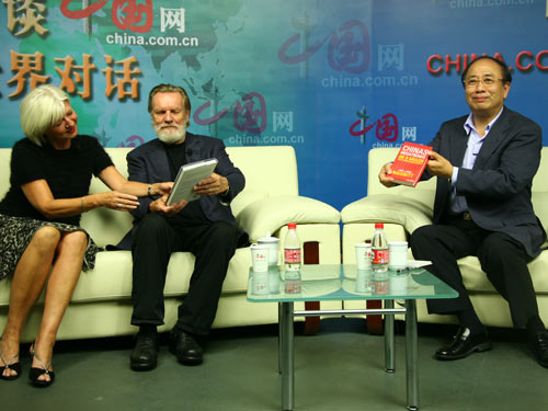 Chairman of the Foreign Affairs Committee of the CPPCC and Former Minister of the SCIO, Zhao Qizheng (R), American Futurist John Naisbitt (C) and his wife Doris Naisbitt(L).