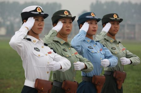 Female soldiers take part in an exercise for the military parade at an airport of People's Liberation Army in Beijing, capital of China, on Sept. 3, 2009. Soldiers are busy doing exercises to prepare for the scheduled military parade at the Tian'anmen square in Beijing to celebrate the 60th anniversary of founding of the People's Republic of China on Oct. 1. (Xinhua/Li Gang)