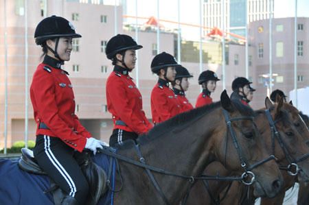 Horseback policewomen form up outside the Dalian World Expo Center, the main meeting center of the Annual Meeting of the New Champions 2009, in Dalian, northeast China