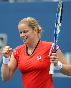 Kim Clijsters of Belgium celebrates her victory over Li Na of China during the women's singles quarterfinals at the U.S. Open tennis tournament in New York, the U.S., Sept. 8, 2009. Kim Clijsters won the match 2-0. (Xinhua/Shen Hong)