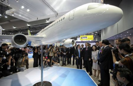 A mockup of jumbo jet C919, the major project of the Commercial Aircraft Corporation of China (COMAC), is displayed at the Asian Aerospace '09 in Hong Kong, China, Sept. 8, 2009. COMAC is a company established in 2008 with the State Council approval to develop C919, the first home-made jumbo jet of China. It is expected to enter service in 2016