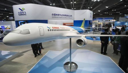 A mockup of jumbo jet C919, the major project of the Commercial Aircraft Corporation of China (COMAC), is displayed at the Asian Aerospace '09 in Hong Kong, China, Sept. 8, 2009. [Xinhua]
