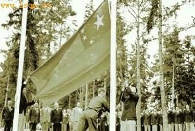 The Chinese Olympic delegation held a flag-raising ceremony at the Olympic village in Helsinki, July 29, 1952.