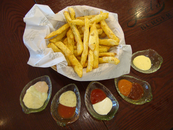 Dress up Let's Burger's Fresh Herb Fries with any of its selection of 13 homemade sauces (pictured here with 10).