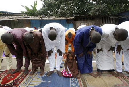 Muslims attend prayers marking the end of Ramadan at a small mosque in Adjame, Abidjan September 20, 2009.