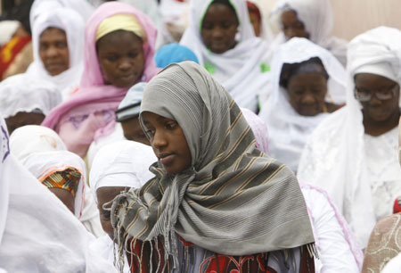 A Muslim girl attends prayers marking the end of Ramadan at a small mosque in Adjame, September 20, 2009.