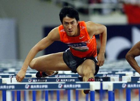 China's 110m-hurdle star Liu Xiang competes during the 110m-hurdle match at the 2009 Shanghai Golden Grand Prix in Shanghai, China, on Sept. 20, 2009. (Xinhua/Fan Jun)