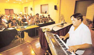 Professor Tao Hongkai (right), an expert on Internet addiction treatment, performs at a summer camp for Internet addicts in Beijing.