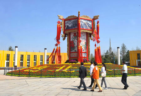 Staffs check the outdoor layout of the Seventh China Flowers Expo in Beijing, China, Sept. 23, 2009. Over 1,300 companies will participate in the Seventh China Flowers Expo that opens on Sept. 26. (Xinhua