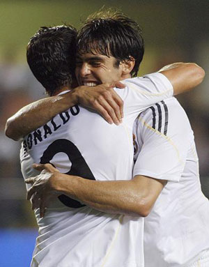 Real Madrid's Kaka (R) celebrates with team mate Cristiano Ronaldo after he scored against Villarreal during their Spanish first division soccer match at the Madrigal Stadium in Villarreal September 23, 2009.