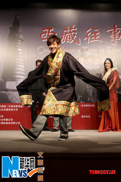 Chinese singer-actor Peter Ho performs a Tibetan dance in Tibetan costume at a ceremony to celebrate the start of shooting 'Once Upon a Time in Tibet' in Beijing, on Tuesday, September 22nd, 2009.