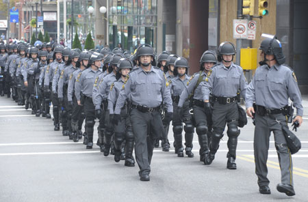Pennsylvania State Troopers patrol on a street in Pittsburgh, Pennsylvania, the United States, Sept. 24, 2004. Pittsburgh beaf up its security for the two-day-long G20 Summit due to open on Sept. 24. (Xinhua/Qi Heng)
