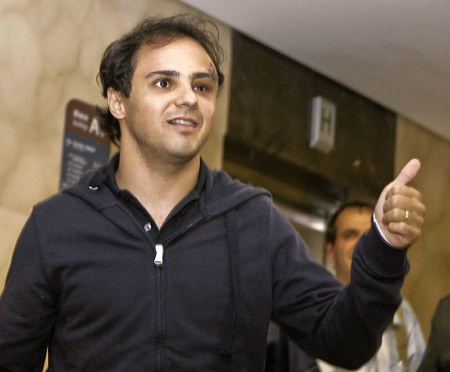 Brazilian Formula One driver Felipe Massa of the Ferrari team gives the thumbs up as he arrives at a hospital in Sao Paulo August 3, 2009. Massa suffered a head injury on July 25 at the qualifying for the Hungarian Grand Prix and spent several days in a coma and on a respirator.