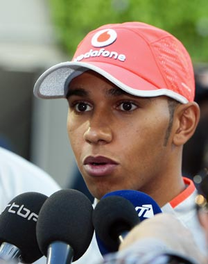 McLaren Formula One driver Lewis Hamilton speaks to the press in the paddock ahead of Sunday's Singapore F1 Grand Prix at the Marina Bay street circuit September 24, 2009.