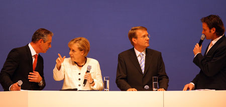 German Chancellor Angela Merkel (2nd, L) attends a campaign rally of the Christian Democratic Union party (CDU) in Berlin, capital of Germany, Sept. 26, 2009. German will vote for general elections on Sunday.