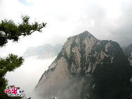 Mount Hua is located in the Shaanxi Province, about 100 kilometres east of the city of Xi'an, near the city Huayin. Hua was historically the location of several influential Taoist temples, and was known as a centre for the practice of traditional Chinese martial arts.[Photo by Li Wenke]