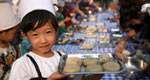 Children make moon cakes to greet Mid-Autumn Festival
