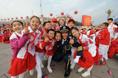 Happy pupils walk into Tian'anmen Square