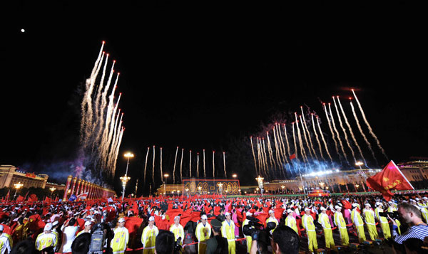 A grand evening gala is held to celebrate New China's 60th anniversary on Oct. 1 evening at the Tian'anmen Square in Beijing. Red, pink, white and orange fireworks shot up into the night sky, lighting up the Tian'anmen Rostrum.