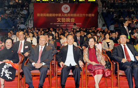 Tung Chee-hwa (2nd L Front), vice chairman of the National Committee of the Chinese People's Political Consultative Conference, and Donald Tsang (C Front), chief executive of Hong Kong Special Administrative Region, attend an evening gala celebrating the 60th anniversary of the founding of the People's Republic of China, in Hong Kong, south China, Oct. 2, 2009.
