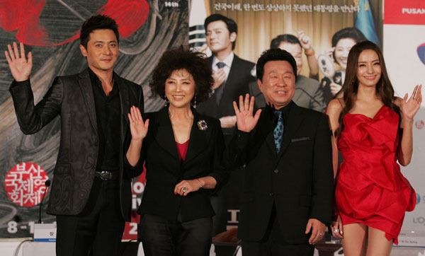 Cast members (from left to right) Jang Dong-gun, Goh Doo-shim, Lim Ha-ryong, and Han Chae-young attend a photocall at the premiere of 'Good Morning, President', the opening film of the 14th Pusan International Film Festival on October 8, 2009 in Busan, South Korea.
