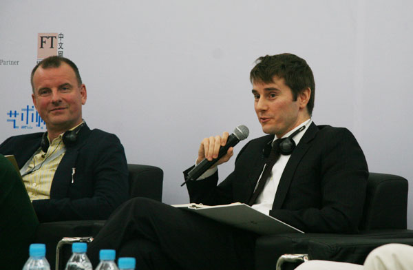 Nick Simunovic (right), director of Gagosian Gallery Hong Kong, gives a speech at the Global Collecting Forum on October 11, 2009 in Beijing.