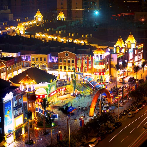 Dongguan's central business district shows off its bright lights. Dongguan, which has a population of 7 million and is 100 kilometers from Hong Kong, owes much of its prosperity to contract manufacturing for major brands and multinationals. [File photo]