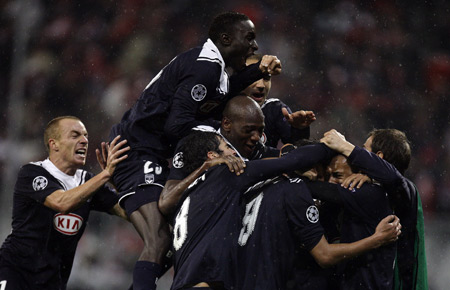 Bordeaux players react after fellow team member Marouane Chamakh scored a goal during their Group A Champions League soccer match against Bayern Munich in Munich, southern Germany, Tuesday, Nov. 3, 2009. Bordeaux won the match 2-0. (Xinhua/Reuters Photo)