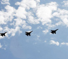 Jet fighters fly over the Tian'anmen Square