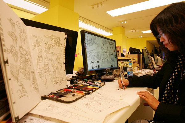 Cartoonist shows how to draw a cartoon book.