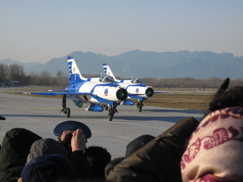 Photo taken on November 15 shows two J-7GB air fighters just finish performance and greet the crowd during an air force show in Beijing Shahe airport. [Jiang Yiping/China.org.cn]