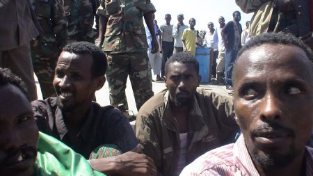 Suspected Somali pirates stay at the northeastern Somali port town of Bossaso, Nov. 18, 2009. The Spanish Navy patroling Somali coast handed over 12 suspected pirates to the local authorities on Wednesday. (Xinhua)