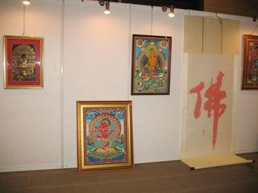 The charity auction includes several Thang-ga paintings as well as woks of calligraphy. [Li Xiao/China.org.cn]