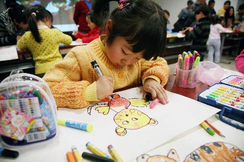 a little girl is engrossed in drawing cartoon painting of tiger in nanjing east chinas - Drawing And Painting For Kids